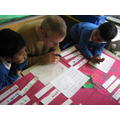 Simon learning how to write his name in Bengali