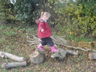 Pretending to cross hot lava using wooden logs