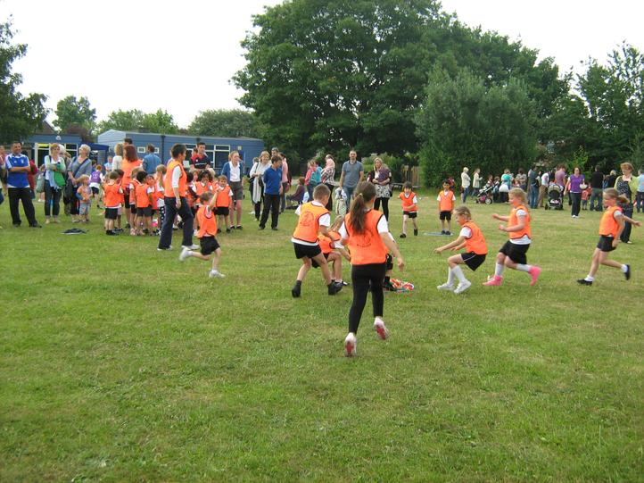 Our Rugby Pups Magpie game.  Go Team Orange!
