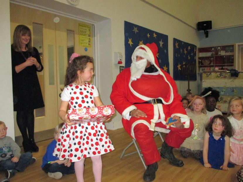 Lidia receiving her gift from Father Christmas