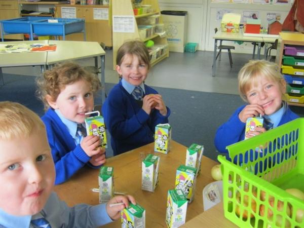 We have milk and a healthy snack each day.
