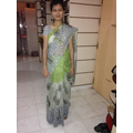 Gauri wearing her sari for a special day at school