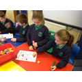 Playing board games to practise our numeracy!