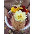 Offering is a coconut with flowers placed on top.