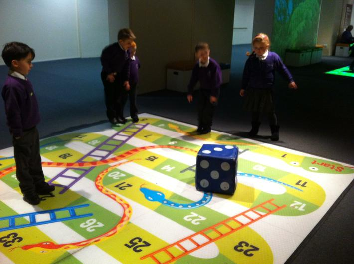 We had great fun playing snakes and ladders!
