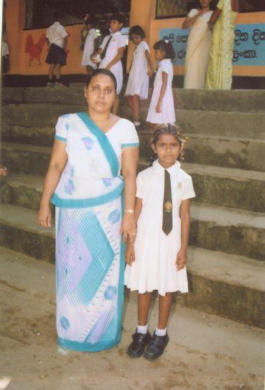 Hiruni at her new school with her class teacher