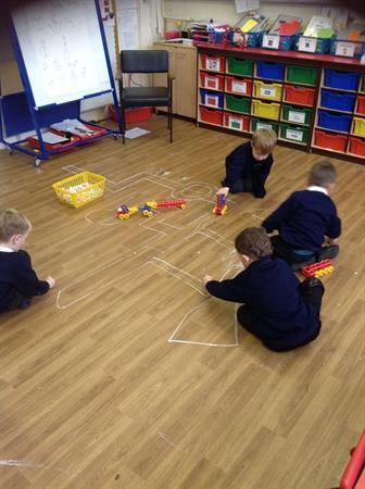 Using chalk to make our own car track