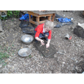 Exploring in the mud kitchen
