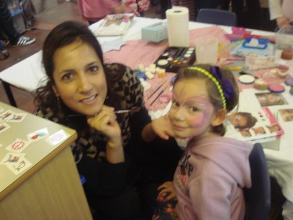 Thea sits for a face painting!