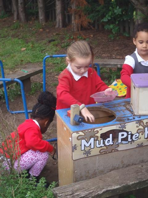 We make mud pies in the mud kitchen.