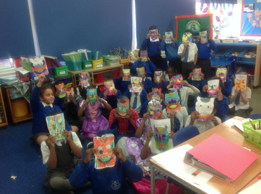 We made Chinese lion masks to frighten Ms Butler!