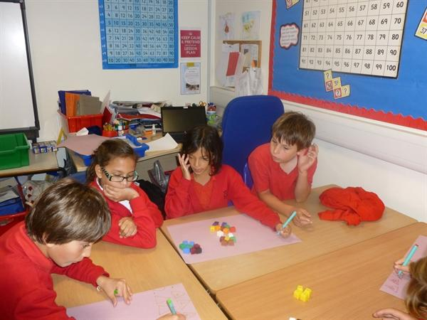 Miss P's numeracy group working together