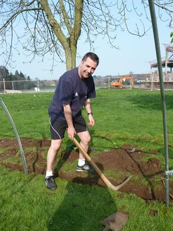 Mr Weatherall helping to build the polytunnel