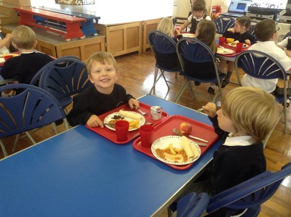 Enjoying our school dinners!