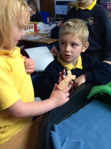 Acting out the story with finger puppets