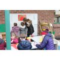 Angel teaching children to write in Reception