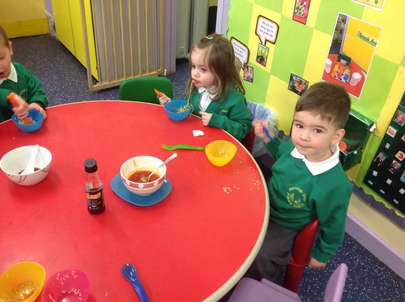 Emily & George enjoying noodles, rice & crackers.