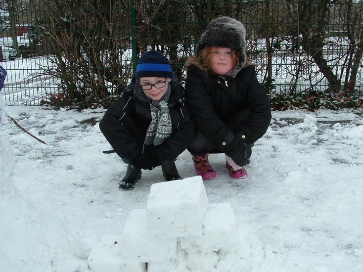 The creators of the snow pyramid.
