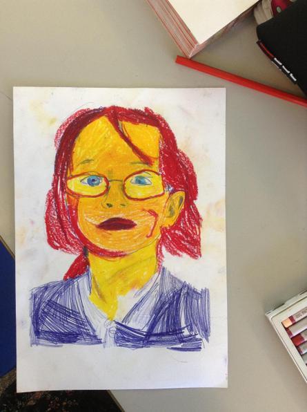Sophia using oil pastels.