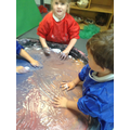 Writing in coloured shaving foam.