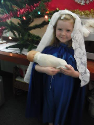 Mary proudly shows us the Baby Jesus