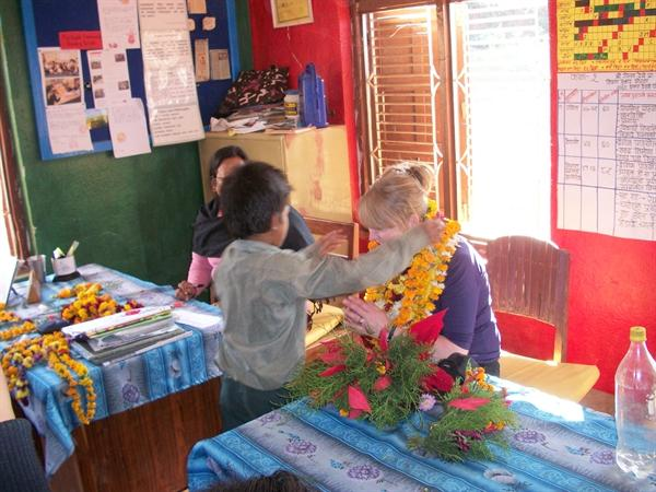 Children greeted me with handmade garlands.