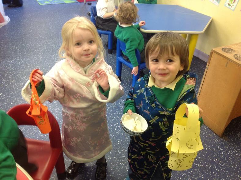 Katy and Jamie wearing traditional Chinese tunics.