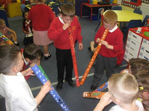 Playing didgeridoos