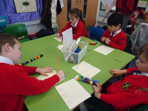 Maths-Finding 1/2 and 1/4 of numbers.
