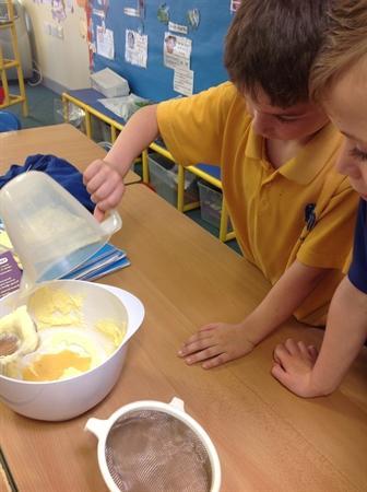 Ryan carefully pouring in the yolk