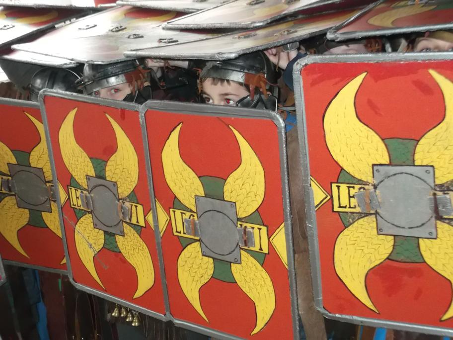 Year 4 perfect the Testudo formation at Arbeia Roman Fort.