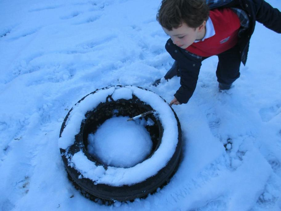 Jack enjoyed sweeping the snow off the tyres