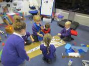 During this Autumn Term we have been very busy making new friends, exploring our new envrionment and trying hard to be more independent!  In the pictures below you can see we have been learning all about our changing world.  We went on an Autumn walk to find evidence of the changing seasons and we made our own seasonal trees!  We especially liked making our winter tree with all the sparkles and glitter! 4