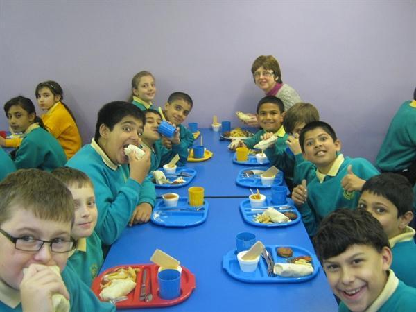 Mrs Robinson + Y6 enjoying their Tandoori chicken!