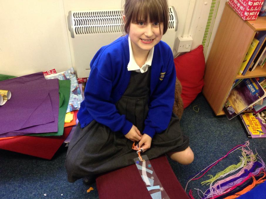 We are making our own Christmas bookmarks.