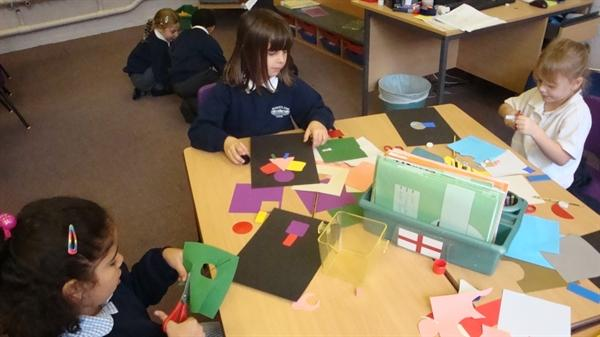 Busy making 2-D shape monsters!