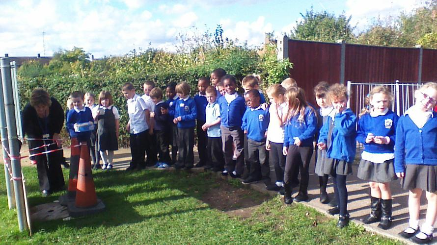 Class 2A are burying our time capsule!
