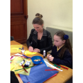 Ellie and mum making shields
