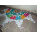 Powder paint  festival decorations outside homes.