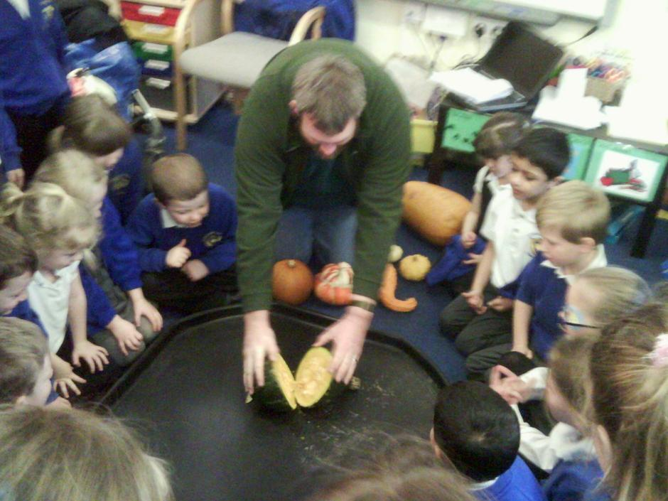 Mr Henderson teaching class 1 about pumpkins.