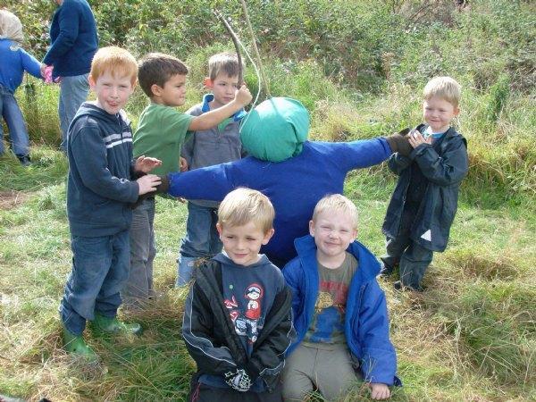 Year 1 children making scarecrows