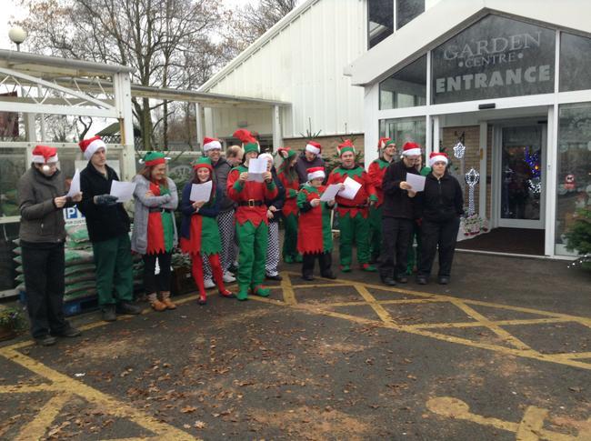 Santa's helpers singing Christmas carols!