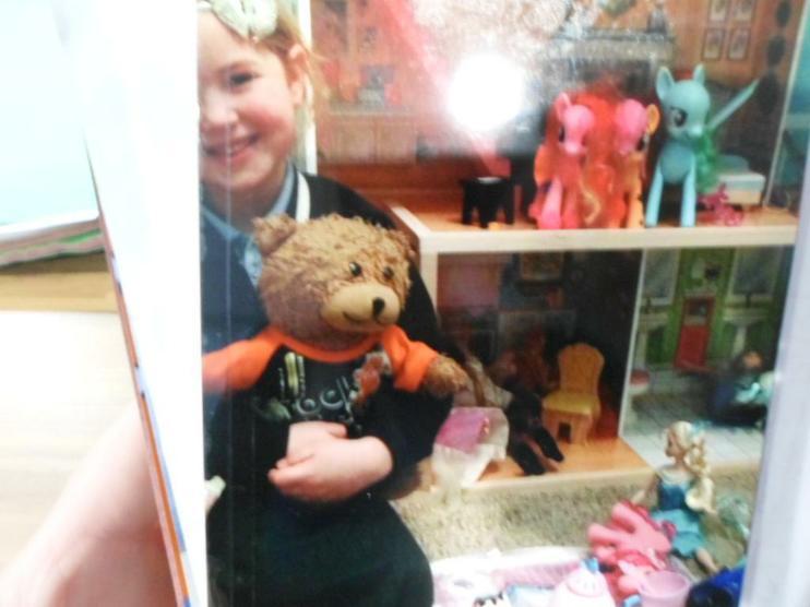 Jofli enjoying himself in the dolls house.