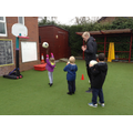 Children in sports club try basketball.