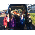 Y6 children helping to load 90kg of food!