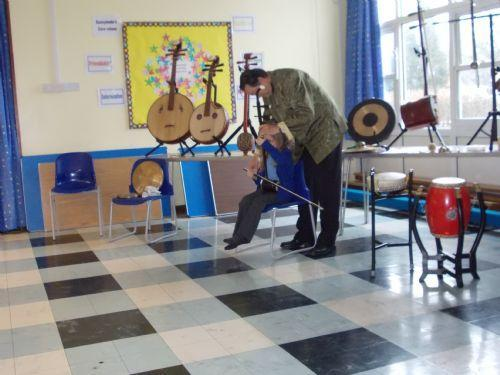 Chinese musician shows us to play the instruments