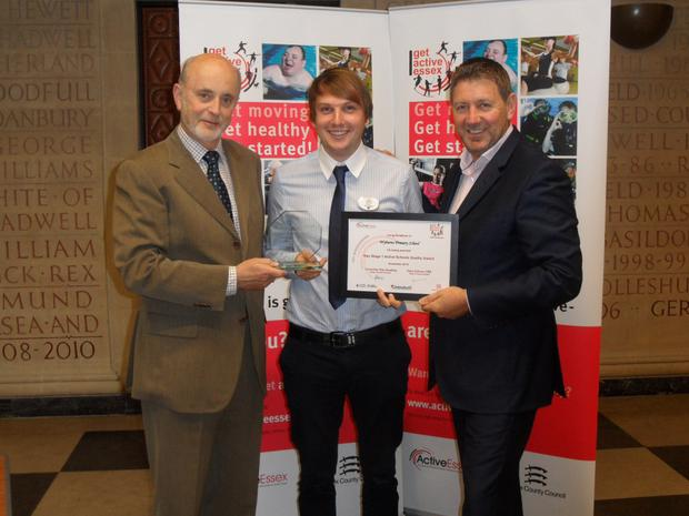Mr Baker receiving Active Essex, Essex County Council, Key Stage 1 Active Schools Award.