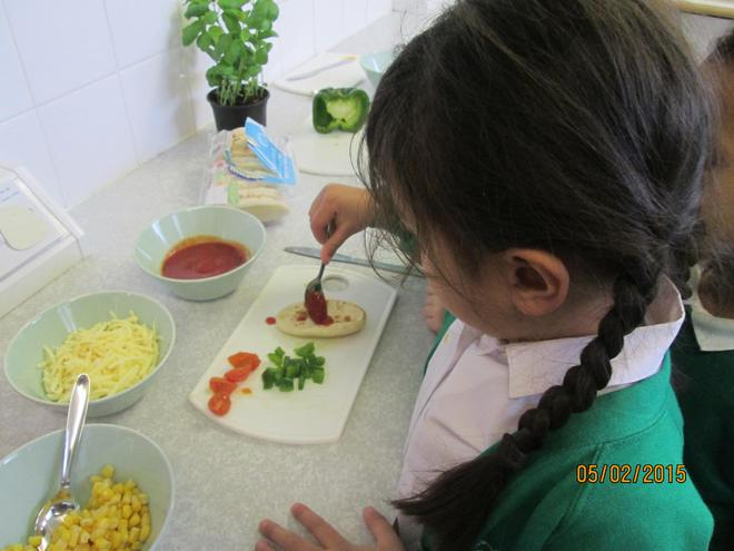 First we spread on the passata.