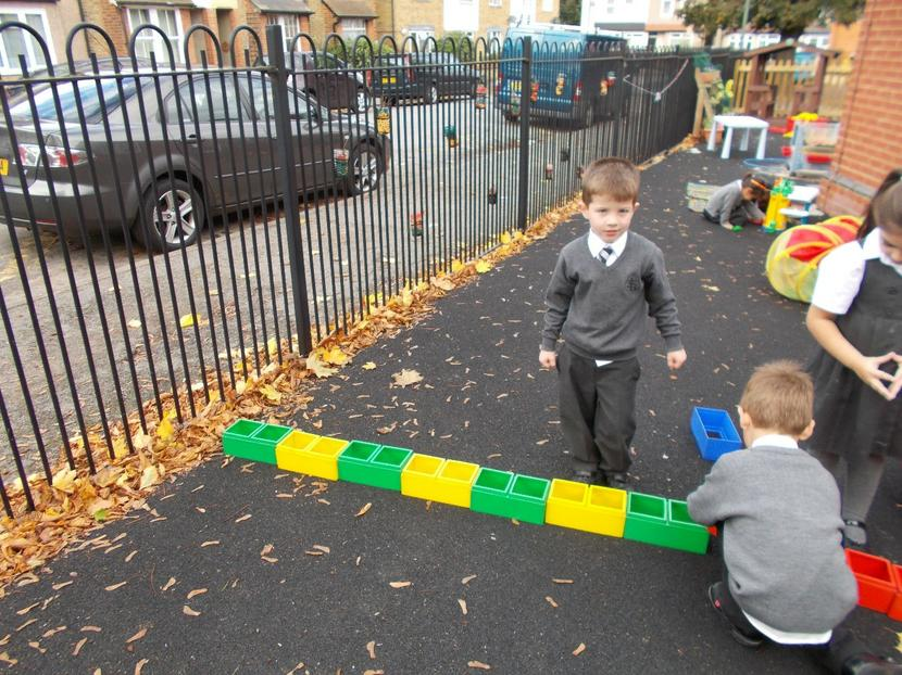 Tom and Freddie use the blocks outside