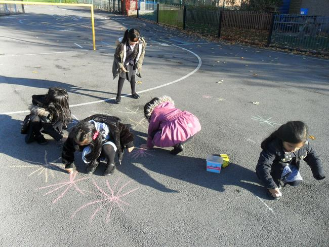 We used chunky chalks to design firework patterns.